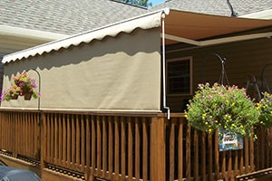Manual retractable awning.